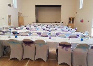 St Michaels Mead Wedding Reception Photo shows decorated tables and chairs